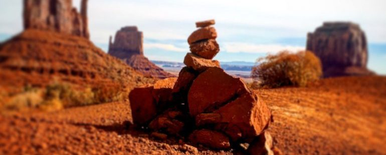 Picture of a stack of rocks in the desert.