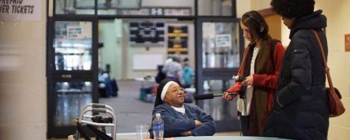 Stacia Brown interviewing a nun