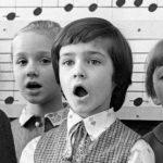 young boy singing