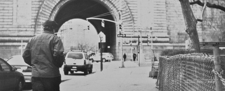 man-walking-black-and-white