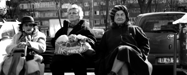 older women on a bench; black and white