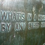 """Weathered plaque reading """"What's in a name by any other..."""""""