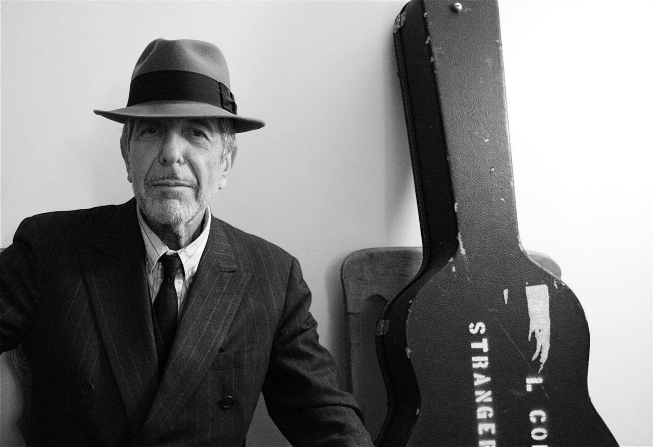 Leonard Cohen with guitar