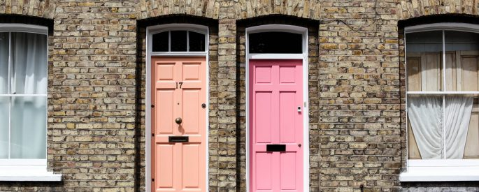 Two doors, orange and pink, in the daylight