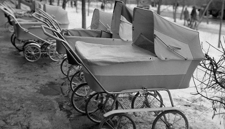 line of old-fashioned baby carriages