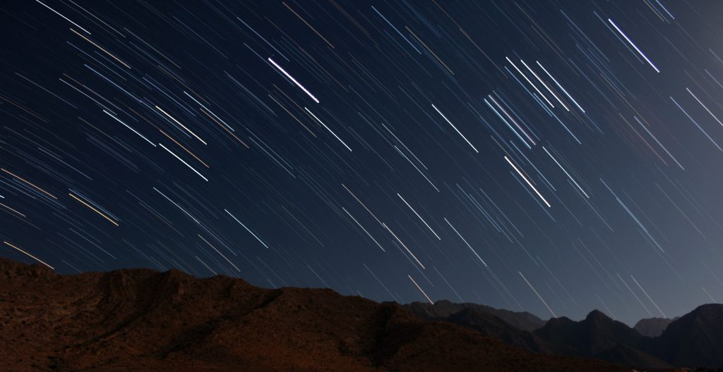 sky at night with shooting stars