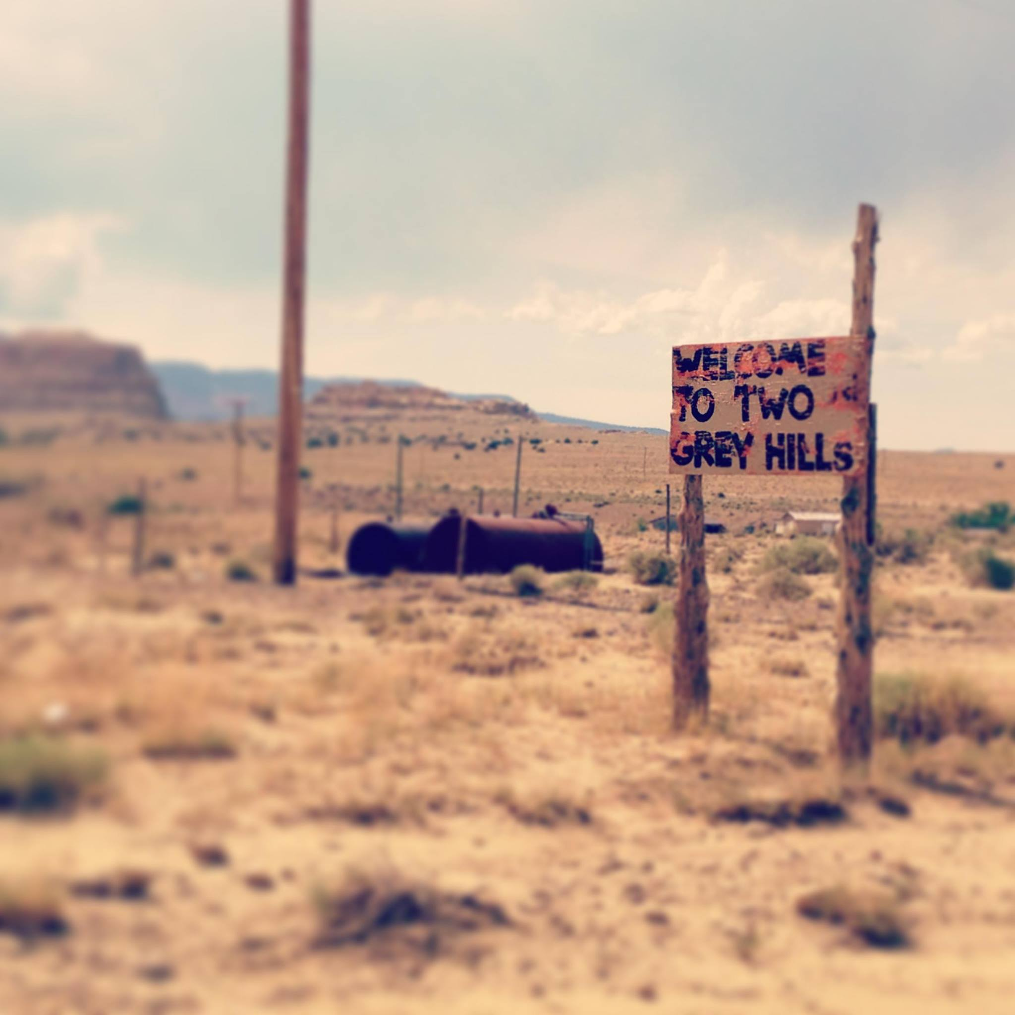 two grey hills and welcome sign