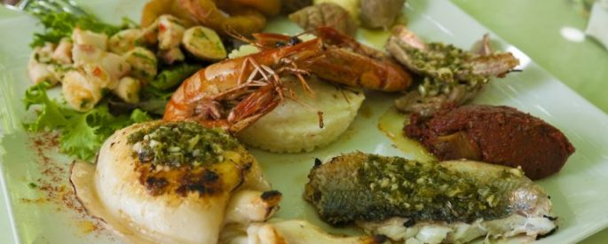 Shrimp and other assorted food on a plate