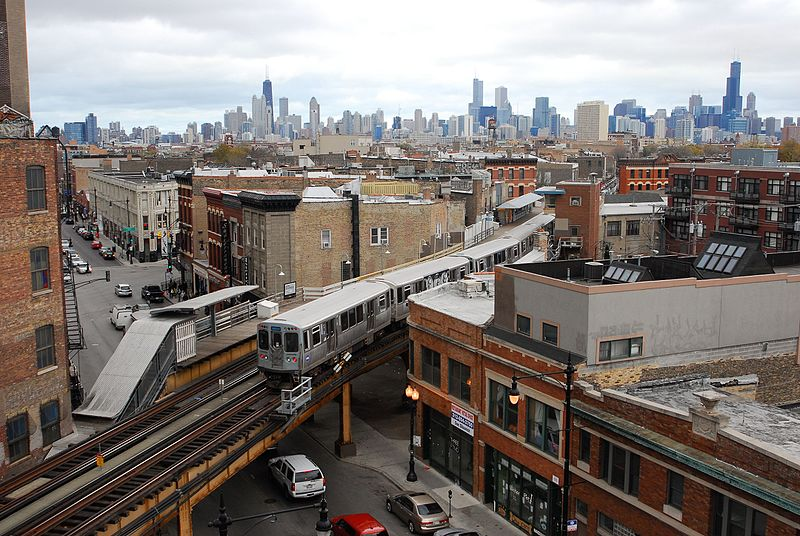 Sky view of Chicago, focused on the train.