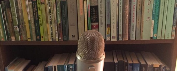 microphone in front of bookshelf