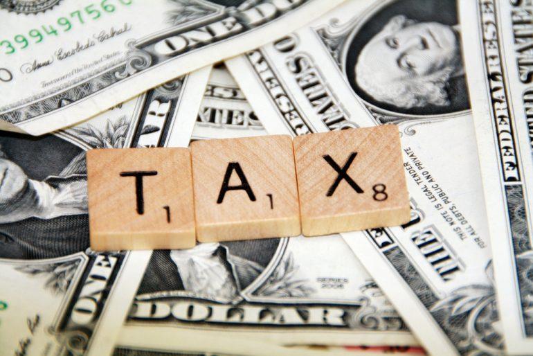 tax in scrabble tiles, on money