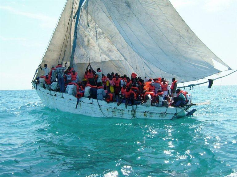 migrants sailing boat