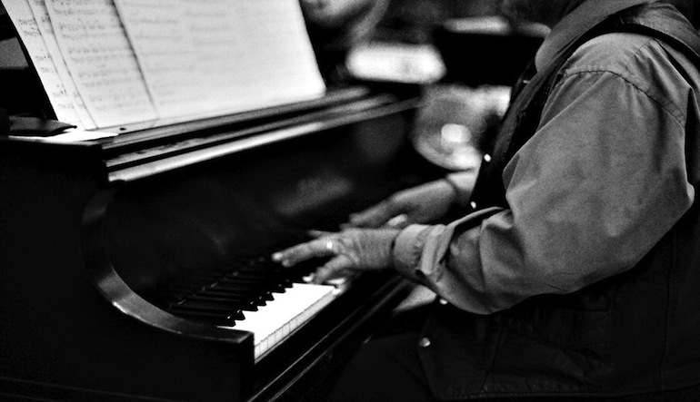 Person playing piano.