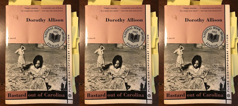 """Book cover for """"Bastard out of Carolina"""" by Dorothy Allison. The cover shows a black and white photo of two women in a dusty landscape."""