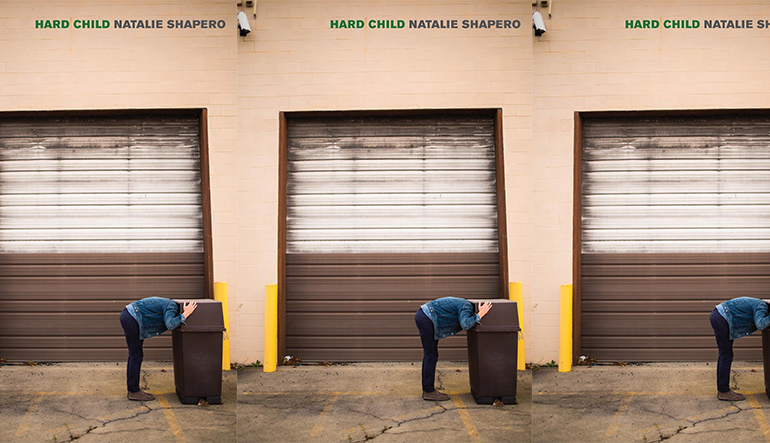 """Book cover for """"Hard Child: by Natalie Shapero. A person sticks their head in a garbage can standing in front of a closed garage door."""