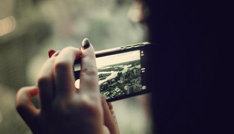City skyline through a smartphone camera.