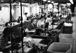 old photo of women sewing in garment factory