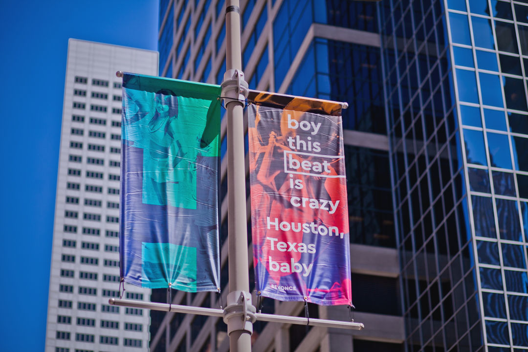 """Street banner reading """"Boy this beat is crazy Houston, Texas baby"""""""
