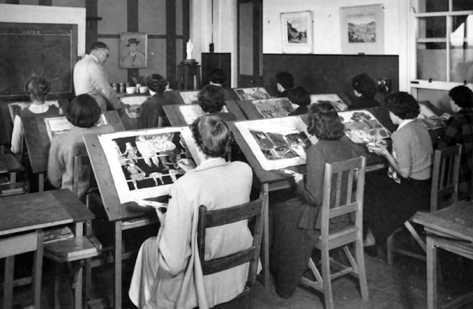 Women sitting in rows painting on canvases.