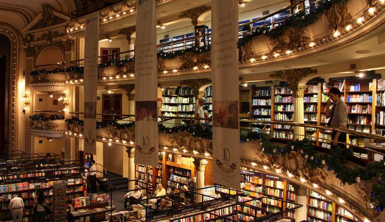 Large building with multiple floors covered in bookshelves.