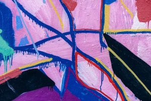Pink, blue, yellow, and black abstract art.