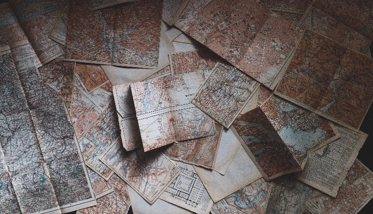 Maps spread out in a pile.