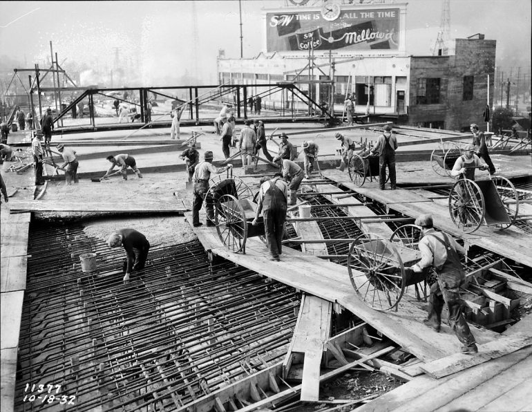 old photo of men working and wagons