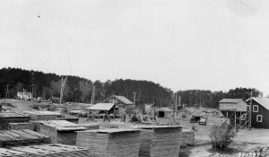 old photo of houses by water