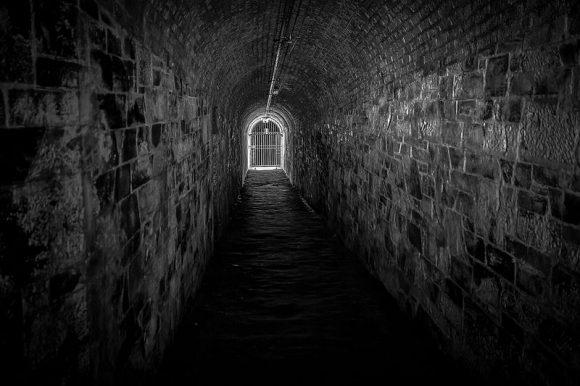 Dark stone tunnel.
