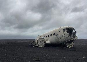 Plane crashed in dark rocky land.
