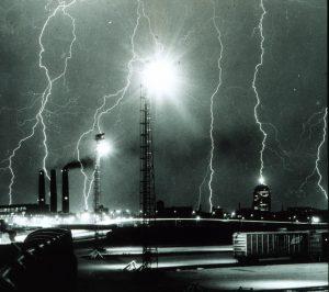 Lightning striking tall buildings.