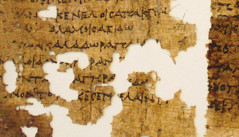 Fragmented pieces of parchment with script.