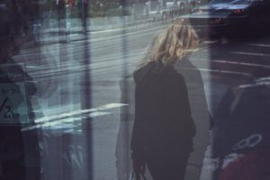 Blurred photograph of a woman walking.