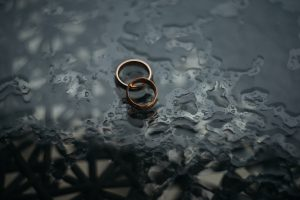 Interlocked rings on a wet surface.