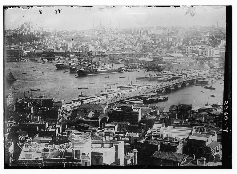 old photo of ships, boats, and docks