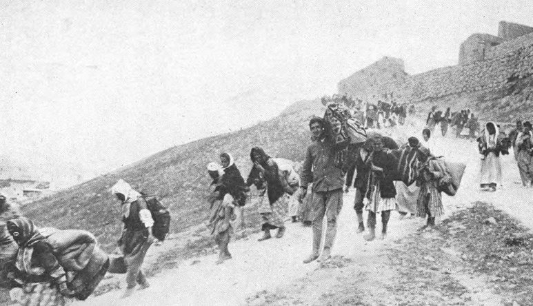 old black and white photo of people walking on trail