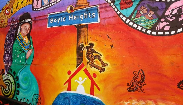 colorful mural with street sign that says Boyle Heights
