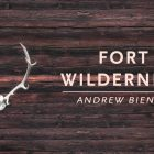 "A piece of wood with antlers attached and the text ""Fort Wilderness by Andrew Bienen"""