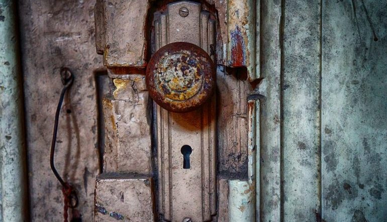 old doorknob crusted in color, a keyhole underneath