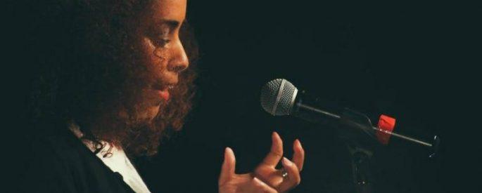 Jasminne Mendez at a microphone
