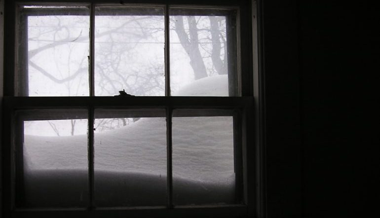 window in a dark room, looking out to a snowy exterior
