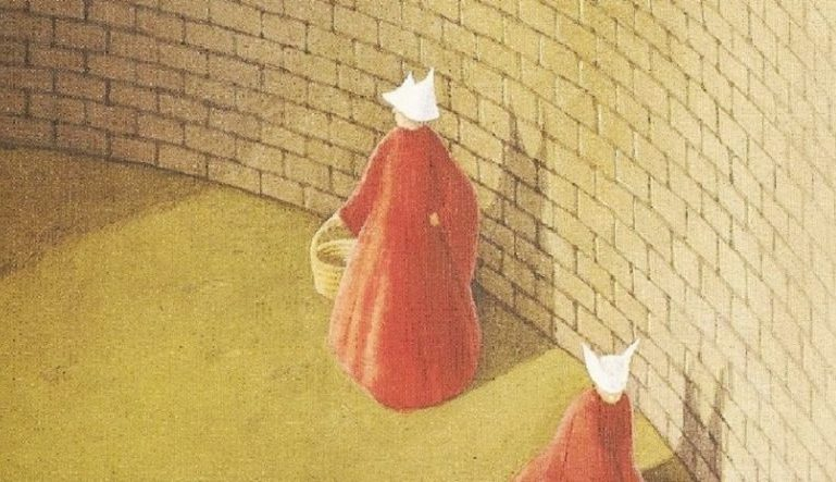 part of The Handmaid's Tale book cover, a drawing of two women in red cloaks and white hats walking in front of a brick wall