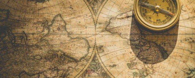 vintage map of the world with a compass on top