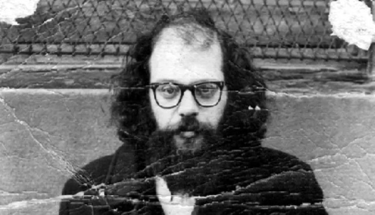 worn, bent, black-and-white photograph of Allen Ginsberg