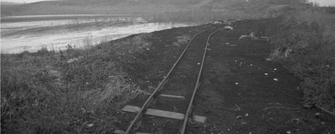 black and white photograph of an old railroad track