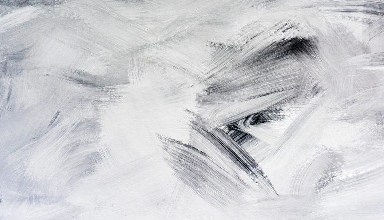 white background with black/grey brushstrokes