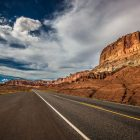 Image of a highway road through red rock canyons.