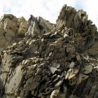 Photograph of a large jagged rock formation