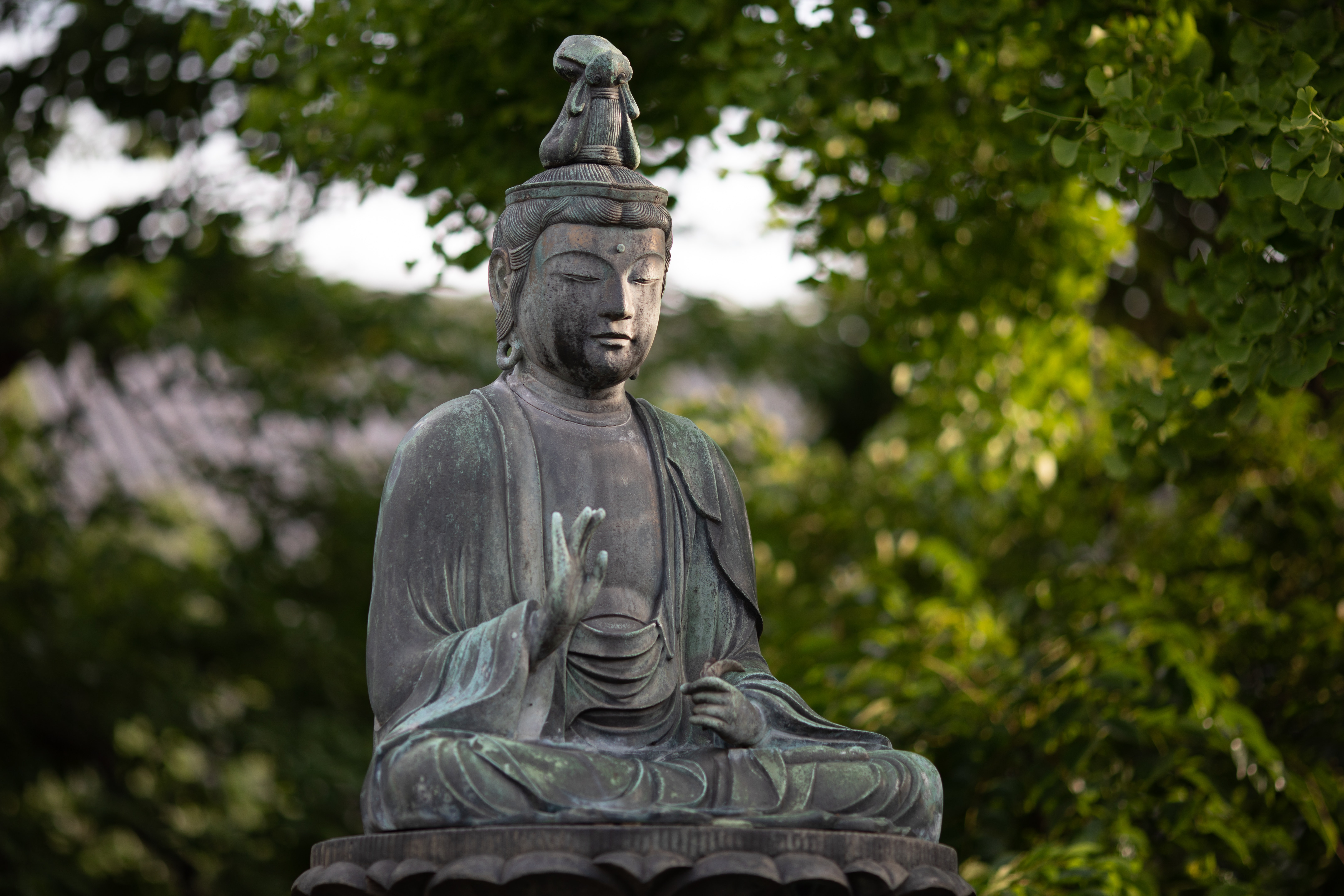 Photograph of an old Buddha statue outdoors