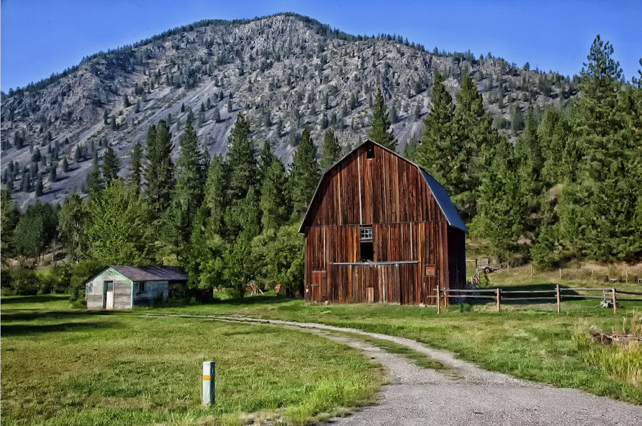 Photograph of a barn and mountains in Montana